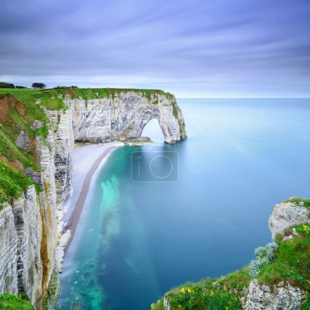 Photo for Etretat, la Manneporte natural rock arch wonder, cliff and beach. Long exposure photography. Normandy, France. - Royalty Free Image