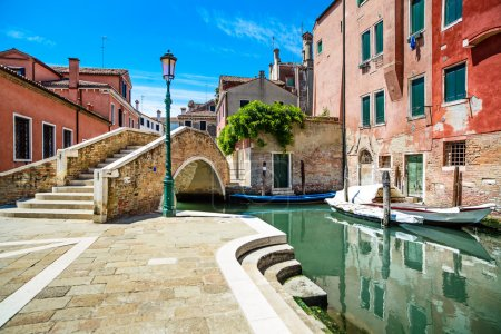 Venice cityscape, water canal, bridge and traditional buildings.