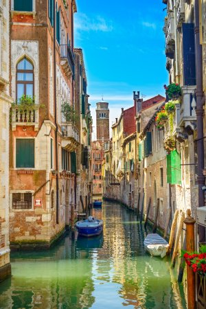 Venice cityscape, water canal, campanile church and traditional buildings. Italy