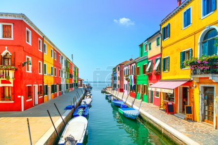 Photo for Venice landmark, Burano island canal, colorful houses and boats, Italy. Long exposure photography - Royalty Free Image