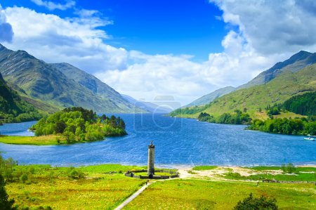 Photo for Glenfinnan Monument and Loch Shiel lake spring landscape. Lochaber, Highlands of Scotland, United Kingdom, Europe - Royalty Free Image