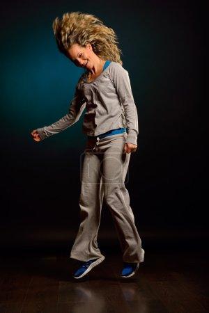 young woman dancing in studio
