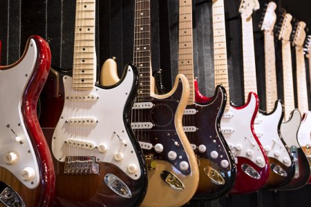 Photo for Many electric guitars hanging on wall in the music instrument shop - Royalty Free Image