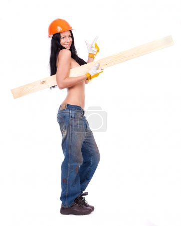 Topless girl in working clothes in the orange helmet