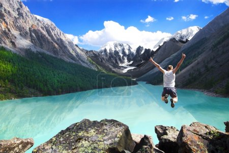 Photo for Beautiful mountain landscape with the lake and the jumping man - Royalty Free Image
