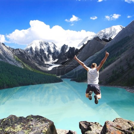 Photo for Mountain landscape with the lake and the jumping man - Royalty Free Image