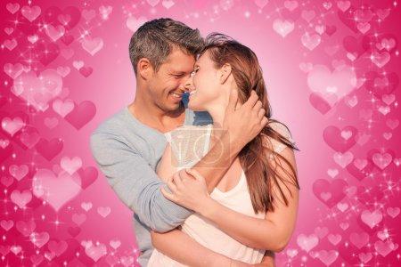 Photo pour Amoureux romantiques sur le mur rouge - image libre de droit