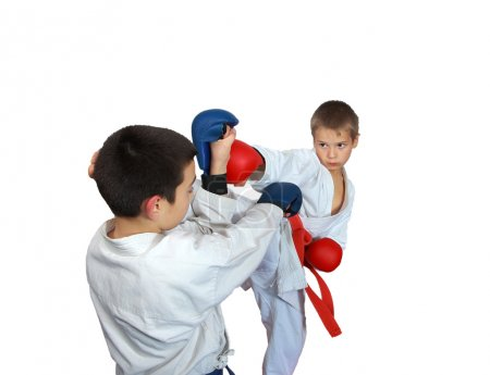 On a white background boys trained karate techniques