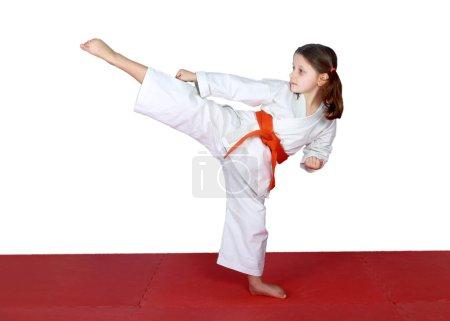 High leg kick in performed little athletes