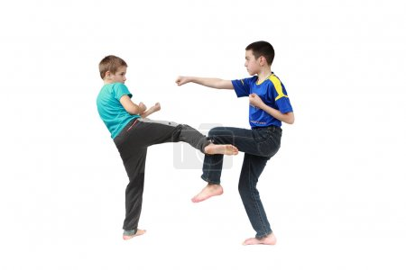 In sportswear clothing two boys are training techniques