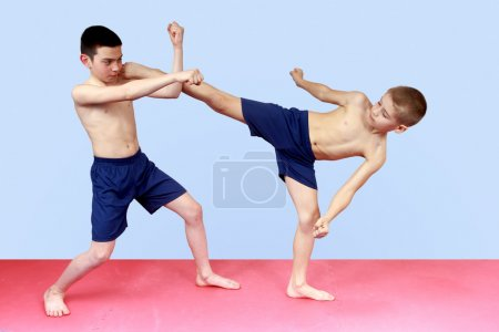 Photo for Sportsmen train in shorts blows arm and leg - Royalty Free Image