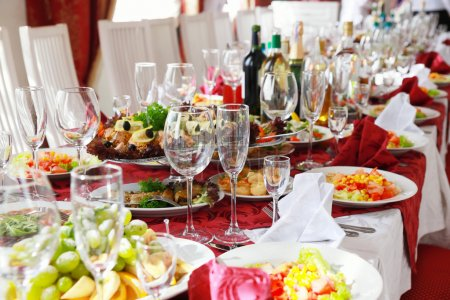 Photo for Served for a banquet table. Wine glasses with napkins, glasses and salads. - Royalty Free Image