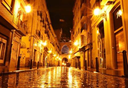 City street in night, Valencia, Spain