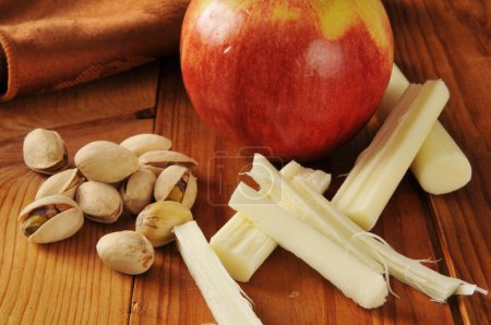 Photo for Pistachio nuts with an apple and string cheese - Royalty Free Image