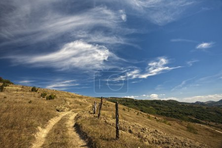mountain and blue sky with clouds