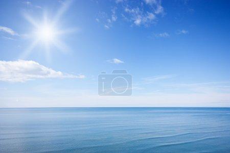 Sunny blue sky and ocean