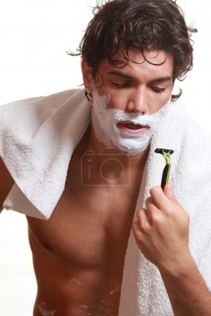 Face covered by foam while shaving