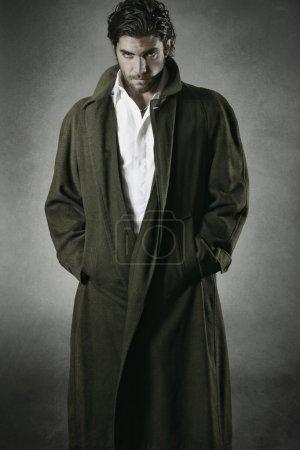 Male vampire portrait against grey background...