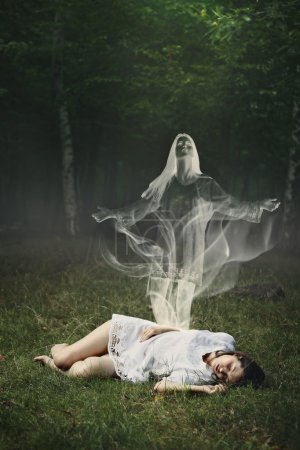 Soul of a sleeping woman in a forest