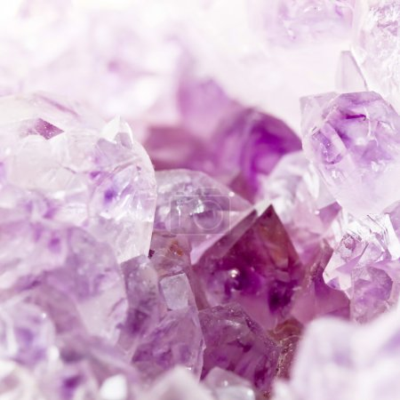 Purple amethyst crystals close-up
