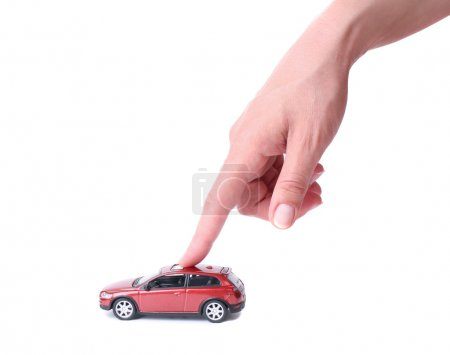 Female hand and the toy car