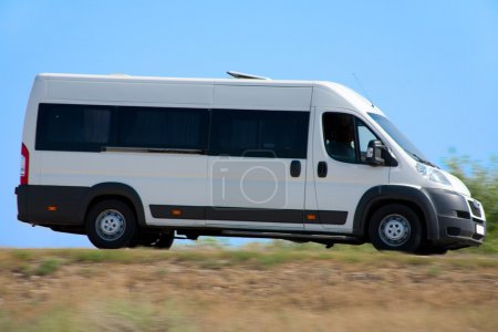 Minibus goes on country highway