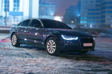Black car at winter night