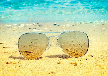 Aviator sunglasses on beach