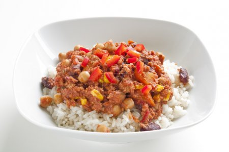 Photo for Rice with chili con carne and red chili peppers - Royalty Free Image