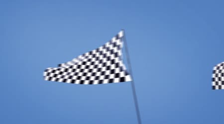 Checkered flag track cam at left side