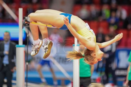 Photo for GOTHENBURG, SWEDEN - MARCH 2, 2013 : My Nordstroem (Sweden) competes in the qualification of the women's high jump event during the European Athletics Indoor Championship on March 2, 2013 in Gothenburg, Sweden. - Royalty Free Image