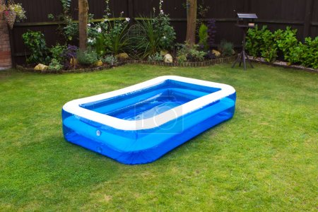 An inflatable swimming pool in an english garden