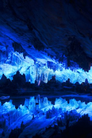 """The beautifully illuminated Reed Flute Caves displaying the """"Crystal Palace of the Dragon King"""" formations. Located in Guilin, Guangxi Provine, China"""