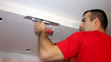Man Applying Plaster on a Dry Wall