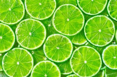 Photo pour Tranches de fond citron vert - image libre de droit