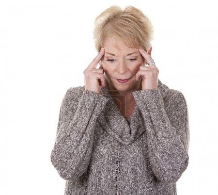 Photo for Casual blond woman in her fifties having a headache - Royalty Free Image