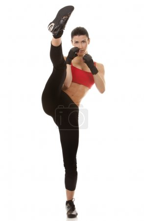 Photo for Athletic brunette wearing boxing gloves on white isolated background - Royalty Free Image