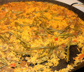 Cooking paella typical from Valencia Spain recipe with rice bean