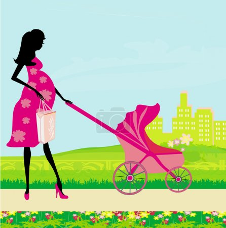 Beautiful pregnant woman pushing a stroller