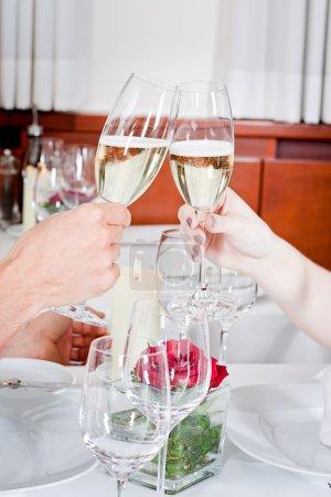 happy smiling couple in restaurant celebrate