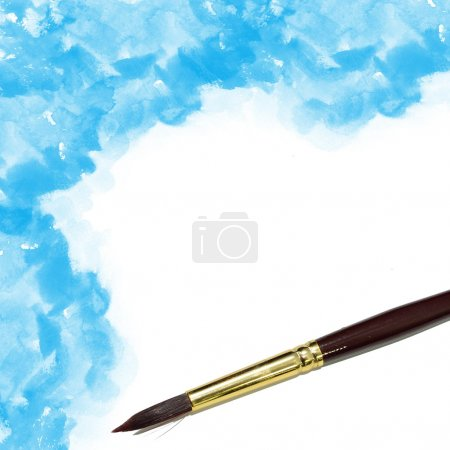 Background with artists brush and blue watercolor painted