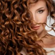 Beautiful young woman with long curly hair...
