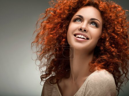 Photo for Red Hair. Beautiful Woman with Curly Long Hair and Sunglases - Royalty Free Image