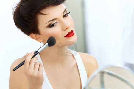 Beauty Girl with Makeup Brush.