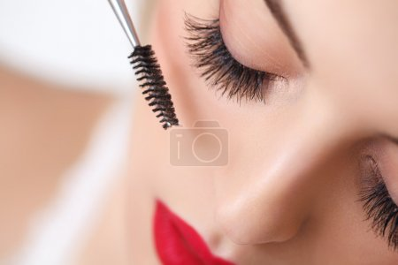 Woman with beautiful makeup and long eyelashes