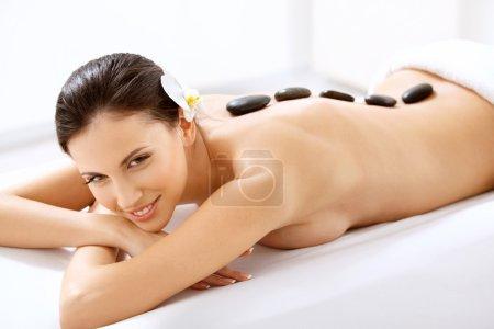 Woman Getting Spa Hot Stones Massage