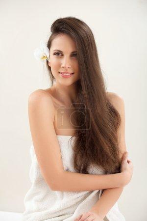 Brown Hair. Beautiful Brunette with Long Hair. Hai...