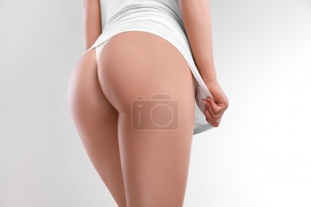 Photo for Closeup of a Beautiful Woman Showing Perfect Buttocks - Royalty Free Image