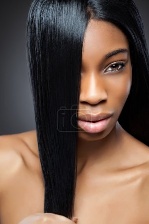 Beautiful black woman with long straight hair