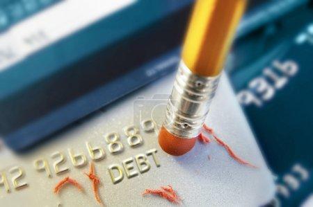Photo for Pencil erasing credit card debt - Royalty Free Image